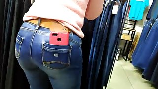 round ass saleswoman in tight jeans