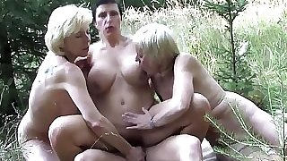 Mature ladies sharing a youthfull boy outdoor