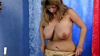 Busty mature rubbing her pussy